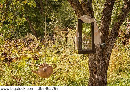 Washstand And Mirror On A Tree In The Countryside