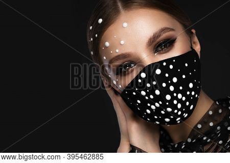 Portrait Of A Beautiful Woman In A Black Mask With Pearls And Classic Makeup. Mask Mode During The C