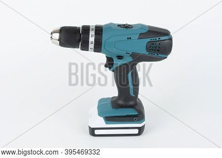 Green Cordless Hammer Screwdriver Drill On White Background. The Drill Can Be Used As A Drill Hammer