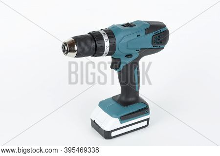 Green Cordless Hammer Screwdriver Drill On White Background. The Tool Can Be Used As A Drill Hammer