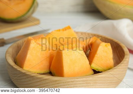 Pieces Of Tasty Melon On Wooden Plate, Closeup