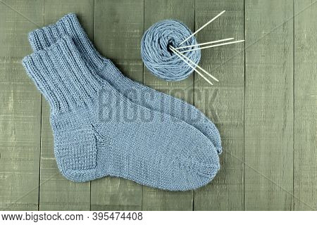 Warm And Beautiful Socks Knitted Of Woolen Threads. Hand Tied Socks. Knitting As A Hobby And A Quara