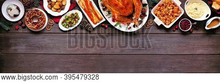 Classic Christmas Turkey Dinner. Overhead View Top Border On A Dark Wood Banner Background With Copy