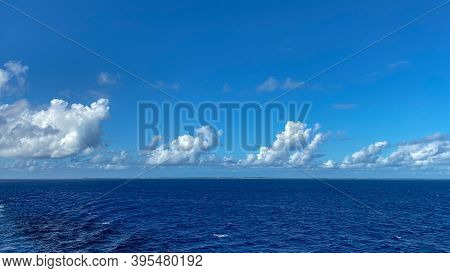 Half Moon Cay, Bahamas - October 31, 2019:  A Distant View Of A Bahamian Island As A Cruise Ship Sai