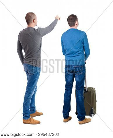 Back view of two man in sweater traveling with suitcas. Back view. Rear view people collection. backside view of person. Isolated over white background.