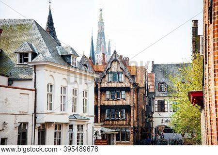 BRUGES, BELGIUM - April 13, 2018: Antique building view in Old Town Bruges, Belgium