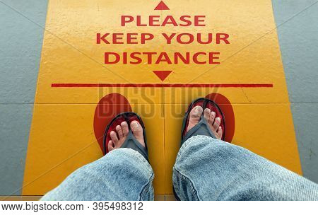 Please Keep Your Distance Sign On A Floor