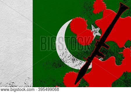 Pakistan Flag And Black Rpg-7 Rocket-propelled Grenade Launcher In Red Blood. Concept For Terror Att