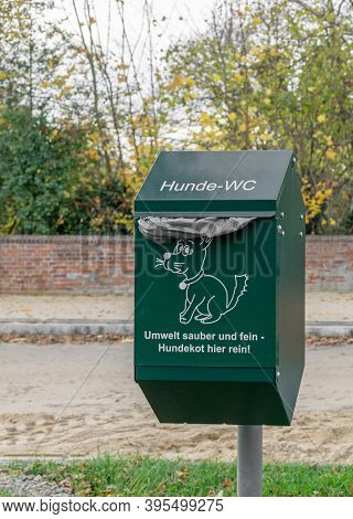 Niedersachsen, Germany November 15, 2020: A Green Metal Bin For Dog Waste In Germany