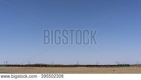 Alakol, Kazakhstan - July 22, 2019: Cargo Train In The Steppe And Desert Of Kazakhstan.