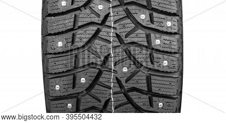 Winter Studded Tire. Winter Car Tires Isolated On White Background. Tire Stack Background. Tyre Prot