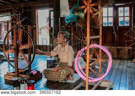 Inle Lake, Myanmar - Nov 09, 2019: Woman Of Padaung Tribe, Karen Long-necked Tribe Weaving Textile S