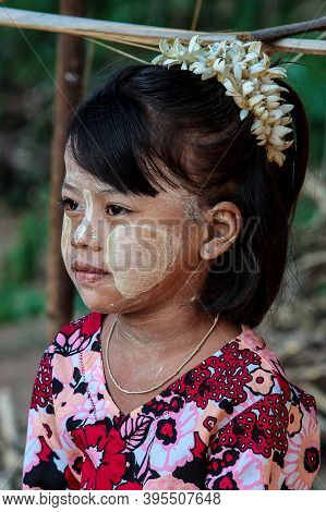 Bagan, Myanmar - Nov 14, 2019: Burmese Girl Rouged With Thanaka In Bagan, Myanmar Former Burma In As
