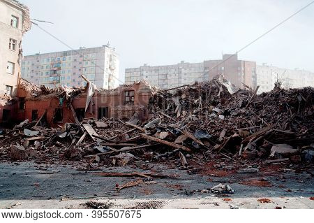 Blurred Image Pile Of Demolition Rubble. Gray Rubble At A Building Site. Demolition Of A House. Conc