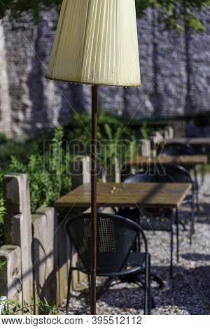 Vintage Lamps On Tables Of A Restaurant In The Medieval Village Of Borghetto Sul Mincio, Verona (ita