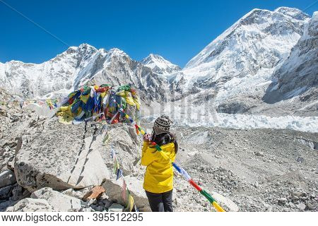 Back View Of Trekker Woman Praying And Respect To The Memorial In Everest Base Camp (5,380 M) The Pl