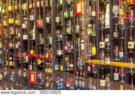Bruges, Belgium - April 10, 2016: Beer Wall In Brugge Bar With Variety Of Bottles And Glasses