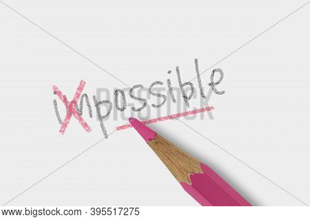 The Word Impossible Corrected With Pink Pencil On White Background - Concept Of Make The Impossible