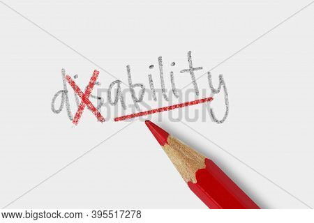 The Word Disable Corrected With Red Pencil On White Background - Concept Of Trasforming Disability I