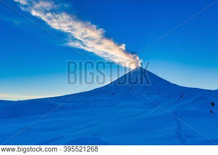 Kamchatka Peninsula, Winter Eruption Active Volcano Klyuchevskaya Sopka At Sunset, Golden Hour. Plum