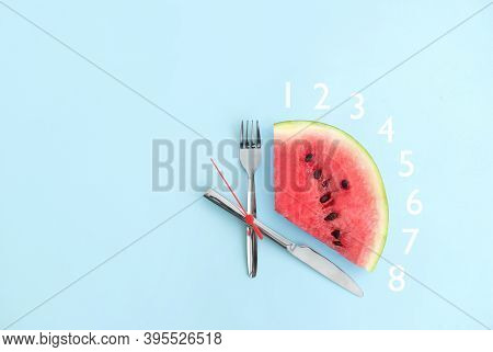 Watermelon With Cutlery As Clock Hands, Eight Hour Intermittent Fasting Diet Concept