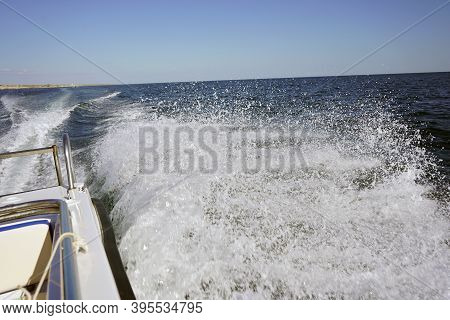 Motor Boat Goes On The Sea, Waves From The Back Of The Speedboat. Video Of Waves, Splashes From A Mo