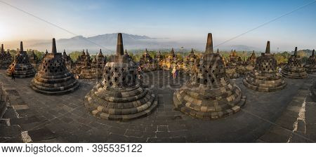Java, Indonesia - 09 September 2018: Tourists Watching Sunrise At Borobudur, A 9th-century Mahayana
