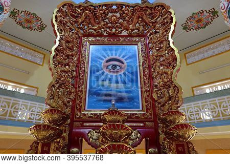 Hoi An, Vietnam, November 19, 2020: The Richly Decorated All-seeing Eye In The Main Hall Of Worship