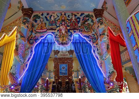 Hoi An, Vietnam, November 19, 2020: Figures Of Different Deities On The All-seeing Eye In The Main H
