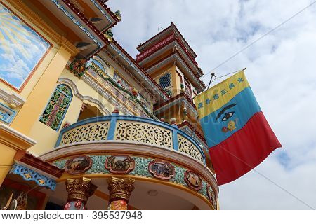 Hoi An, Vietnam, November 19, 2020: Banner With The All Seeing Eye On The Main Facade Of The Cao Dai