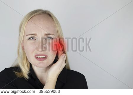 A Woman Suffers From Pain In The Ear. The Auditory Meatus Hurts Due To Otitis Media, Cerumen Plug, E