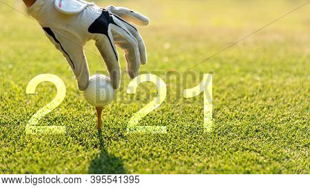 Close Up Hand Golfer Woman Putting Golf Ball For Happy New Year 2021 On The Green Golf For New Healt