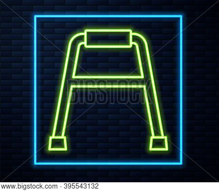 Glowing Neon Line Walker For Disabled Person Icon Isolated On Brick Wall Background. Vector