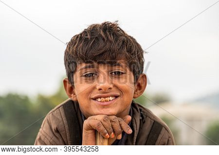 Pushkar, India - November 2020: Close Up Portrait Of A Rajasthani Boy At Camel Mela,pushkar