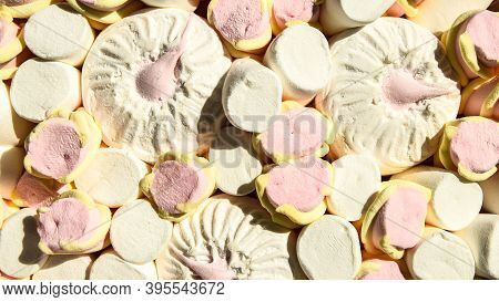 Multicolored Marshmallow Background. Background Of Multi-colored And Different In Shape And Size Of