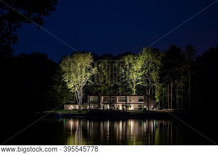 Night Image Of The Modern House On The Lake