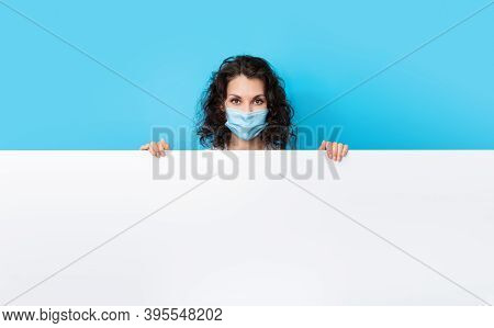 Doctor In Face Mask On Bright Color Background Make Gesture Hand. Girl Wearing Protection Face Mask