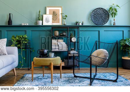 Interior Design Of Living Room With Gray Sofa, Design Pouf, Coffee Table, Shlef, Basket, Carpet And