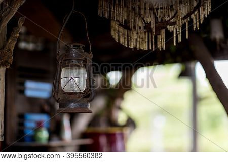 Old Rusty Indian Style Lantern. Vintage Old Lanterns Hanging. Old Style Burning Lantern Hanging Form