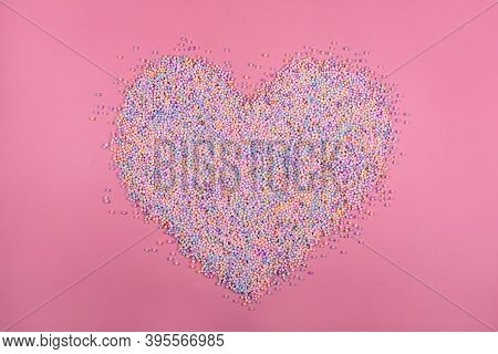 Heart Made Of Pastel Color Balls On Pink. Styrofoam Or Polystyrene Foam Background. Mixed Colorful S