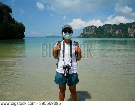 A Woman Wearing Surgical Mask Traveling On Railay Beach In Thailand
