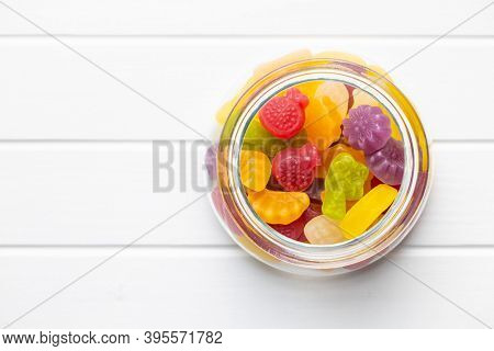 Colorful fruity jelly candies in jar. Top view.