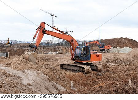 Excavator Dig Trenches At Construction Site. Trench For Laying External Sewer Pipes And Sewage Drain