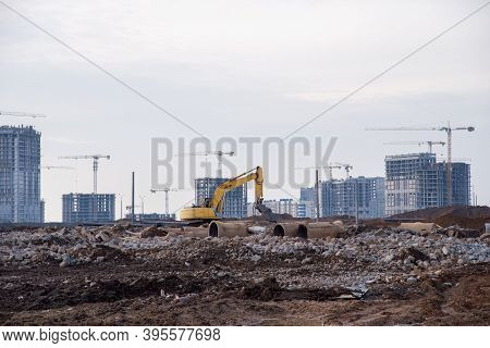 Excavator With Hydraulic Shears Breaks Asphalt And Old Concrete On Construction Site. Hydraulic Shea
