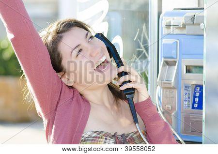 A Happy Woman Talking At Phone