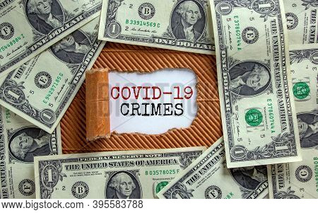 Covid-19 Crimes Concept. The Text 'covid-19 Crimes' Appearing Behind Torn Brown Paper. Dollar Bills.