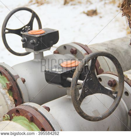 Modern Black Oil Pipe Valve Wheel. Metal, Pipeline And Mechanic Concept. An Old Iron Valve On A Gas