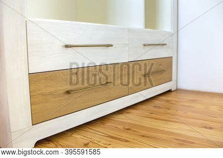 Close Up Of Wooden Drawer In Contemporary Cupboard Cabinet.