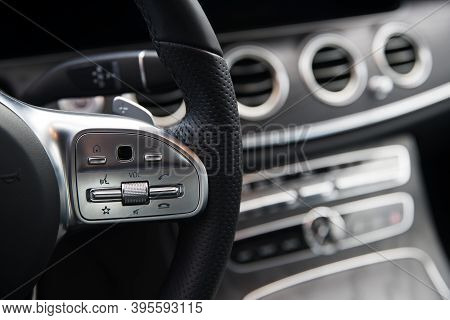 Audio Control Buttons On The Steering Wheel Of The Car At Shallow Depth Of Field