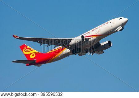Hong Kong / China - December 1, 2013: Hong Kong Airlines Cargo Airbus A330-200 B-lnw Cargo Plane Dep